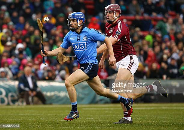 Gearoid McInerney of Galway defends Niall McMorrow of Dublin during the AIG Fenway Hurling Classic and Irish Festival at Fenway Park on November 22...