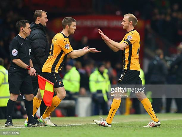 Gearoid Morrissey of Cambridge United replaces Luke Chadwick of Cambridge United during the FA Cup Fourth round replay match between Manchester...