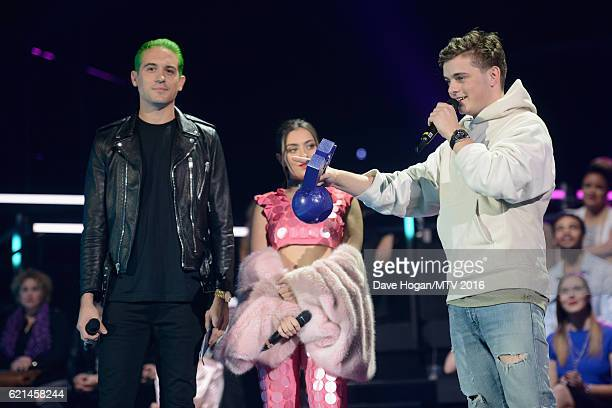 GEazy and Charli XCX present to the award for Best Electronic to Martin Garrix on stage at the MTV Europe Music Awards 2016 on November 6 2016 in...