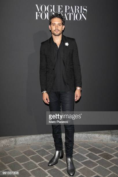 Eazy attends the Vogue Foundation Dinner Photocall as part of Paris Fashion Week Haute Couture Fall/Winter 20182019 at Musee Galliera on July 3 2018...