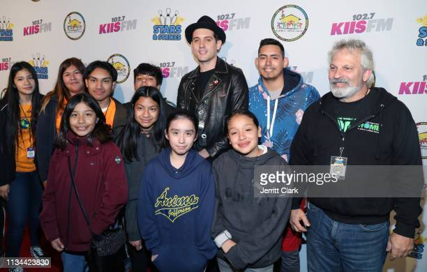 Eazy poses with APCH youth at A Place Called Home's Annual Stars And Strikes Celebrity Bowling And Poker Tournament at PINZ Bowling Entertainment...