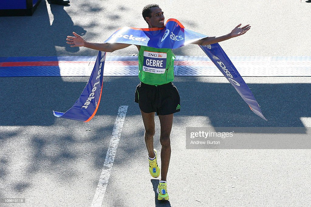 Gebre Gebremariam #14 of Ethiopia throws his hands up after winning the men's division of the 41st ING New York City Marathon on November 7, 2010 in New York City.