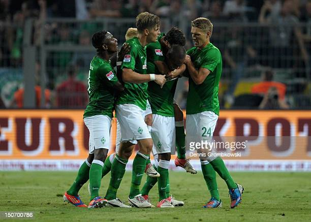 Gebre Salassi of Bremen celebrates with teammates after scoring his team's first goal during the Bundesliga match between Borussia Dortmund and...