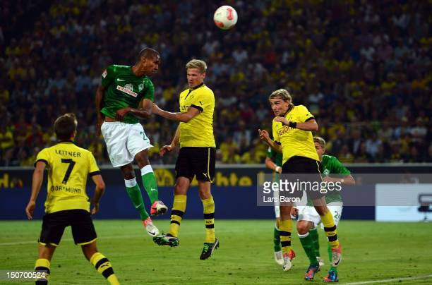 Gebre Selassie of Bremen heads his teams first goal during the Bundesliga match between Borussia Dortmund and Werder Bremen at Signal Iduna Park on...