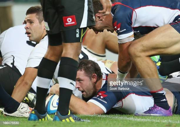 Ged Robinson of the Rebels scores a try during the round nine Super Rugby match between the Rebels and the Kings at AAMI Park on April 13 2013 in...