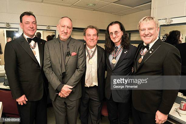 Geddy Lee Alex Lifeson Neil Peart of Rush pose with Pete Townshend and Des McAnuff backstage at the Governor General's Performing Arts Awards 20th...