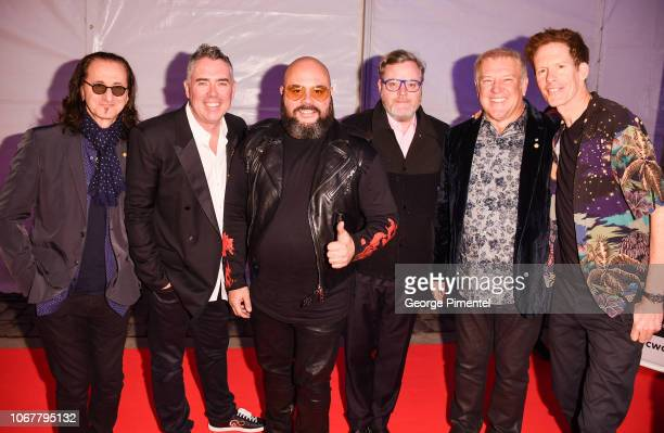 Geddy Lee and Alex Lifeson from the band RUSH pose with the Barenaked Ladies Ed Robertson Tyler Stewart Keven Hearn and Jim Creeggan at the 2018...