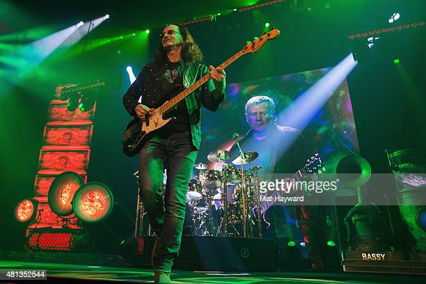 Geddy Lee and Neil Peart of Rush performs on stage during the R40 LIVE Tour at KeyArena on July 19 2015 in Seattle Washington