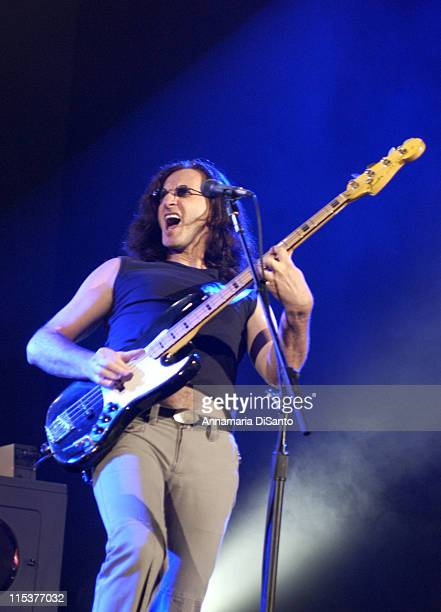 Geddy Lee of Rush during Rush World Tour 2002/2003 at Verizon Amphitheatre in Los Angeles CA United States