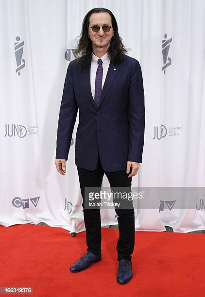 Geddy Lee of Rush, winners of the Allan Waters Humanitarian Award, poses in the press room at the JUNO Gala Dinner & Awards at Hamilton Convention...