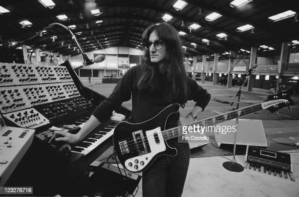 Geddy Lee singer and bassist with Canadian rock band Rush holding his bass guitar on stage during a soundcheck ahead of the band's gig at Bingley...