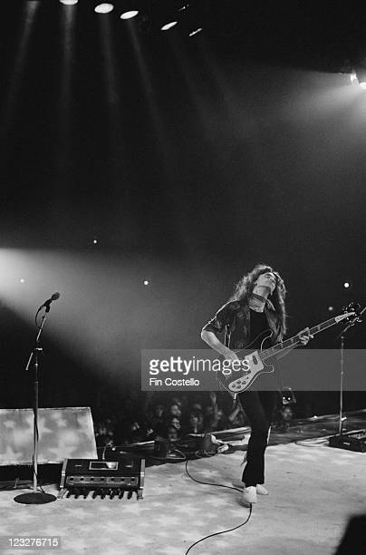 Geddy Lee singer and bassist with Canadian rock band Rush playing his bass guitar on stage during the band's gig at Bingley Hall in Stafford...