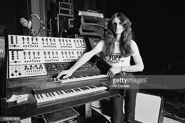 Geddy Lee singer and bassist with Canadian rock band Rush poses beside a synthesizer during a soundcheck ahead of the band's gig at the Gaumont in...