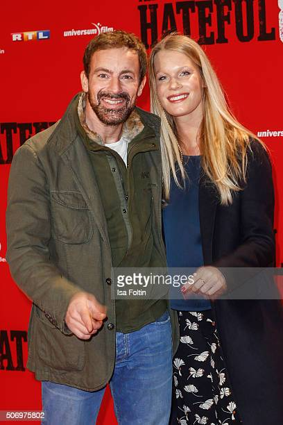 Gedeon Burkhard and Anika Bormann attend the premiere of 'The Hateful 8' at Zoo Palast on January 26 2016 in Berlin Germany