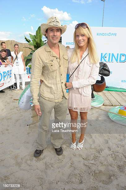 Gedeon Burkhard and Annika Bormann attend the Beach BBQ for the German Premiere of 'Kindskoepfe' at O2 World on July 30 2010 in Berlin Germany