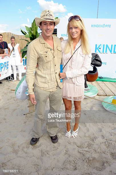 Gedeon Burkhard and Annika Bormann attends the Beach BBQ for the German Premiere of 'Kindskoepfe' at O2 World on July 30 2010 in Berlin Germany