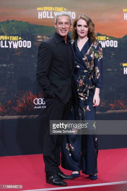 """Gedeon Burkhard and his girlfriend Mary Ellen during the premiere of """"Once Upon A Time... In Hollywood"""" at CineStar on August 1, 2019 in Berlin,..."""