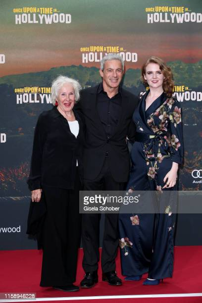 """Gedeon Burkhard and his mother Elisabeth von Molo and his girlfriend Mary Ellen during the premiere of """"Once Upon A Time... In Hollywood"""" at CineStar..."""
