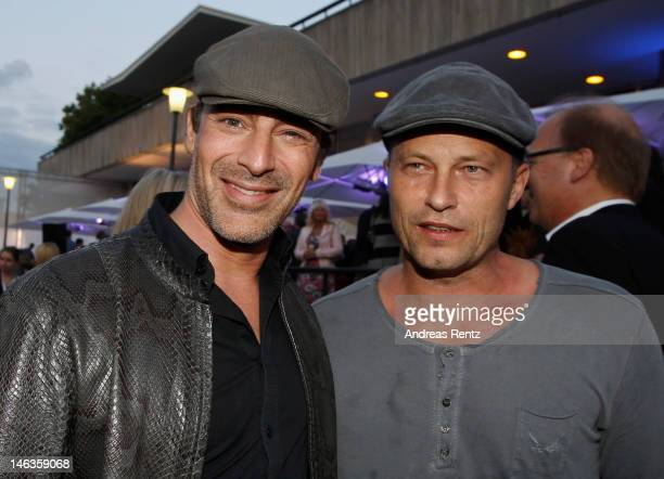 Gedeon Burkhard and Til Schweiger attend the producer party 2012 of the German producers alliance on June 14, 2012 in Berlin, Germany.