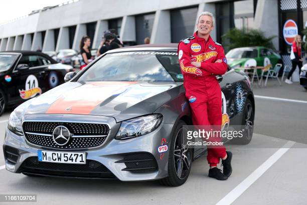 """Gedeon Burkhard during the charity racing """"Place to B"""" for the benefit of """"Ein Herz fuer Kinder"""" on September 5, 2019 in Leipzig, Germany."""