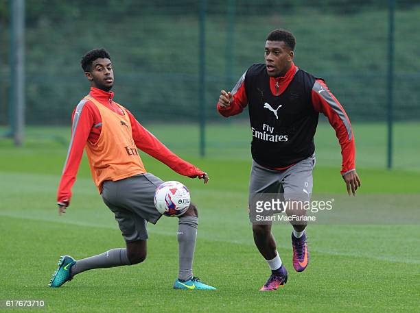 Gedion Zelalem and Alex Iwobi of Arsenal during a training session at London Colney on October 24 2016 in St Albans England