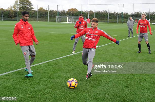 Gedion Zelalem and Alex OxladeChamberlain of Arsenal during a training session at London Colney on November 5 2016 in St Albans England