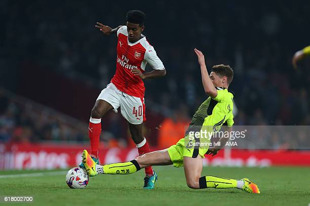 Gedion Zelalem of Arsenal is tackled by George Evans of Reading during the EFL Cup fourth round match between Arsenal and Reading at Emirates Stadium...