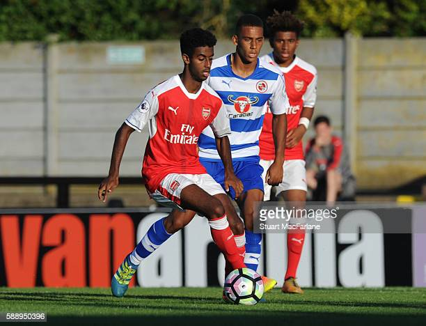 Gedion Zelalem of Arsenal takes on Andy Rhinomitota of Reading during the Premier League 2 match between Arsenal and Reading at Meadow Park on August...