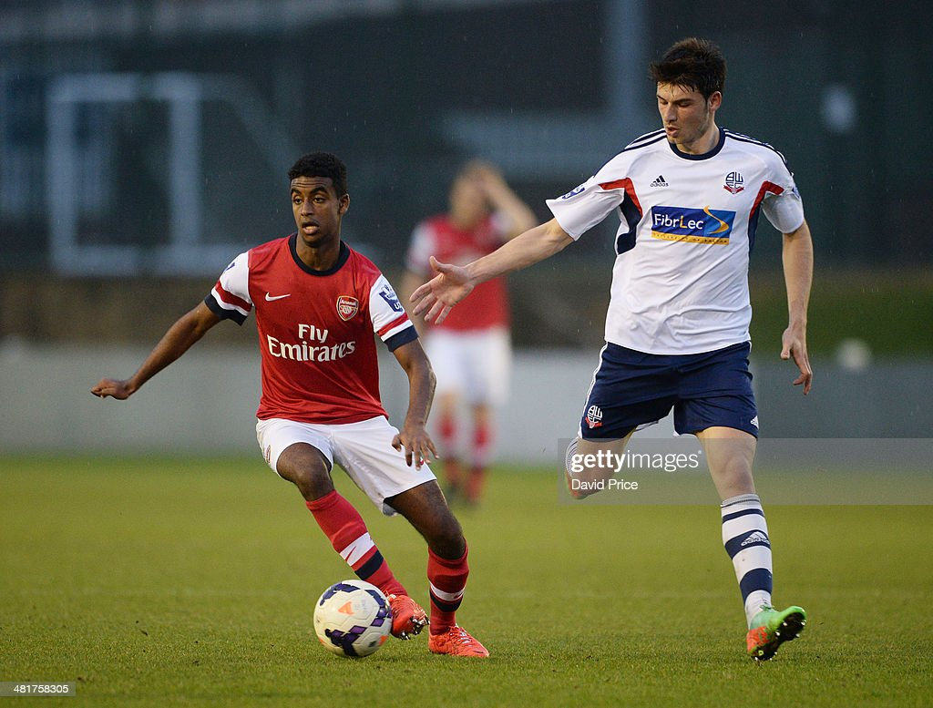 Gedion Zelalem of Arsenal turns away from Zach Clough of Bolton during the match between Bolton Wanderers U21 and Arsenal U21 in the Barclays Premier U21 League on March 31, 2014 in Lancaster, England.