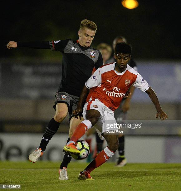 Gedion Zelalem of Arsenal under pressure from Jake Hesketh of Southampton during the match between Arsenal U23 and Southampton U23 at Meadow Park on...