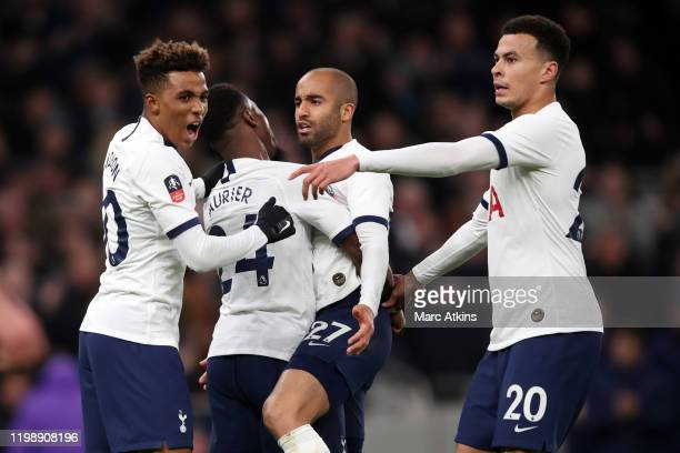 Gedson Fernandes Lucas Moura Serge Aurier and Dele Alli of Tottenham Hotspur celebrate during the FA Cup Fourth Round Replay match between Tottenham...