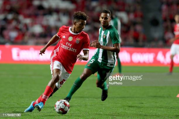 Gedson Fernandes of SL Benfica vies with Filipe Augusto of Rio Ave FC during the Portuguese League football match between SL Benfica and Rio Ave FC...