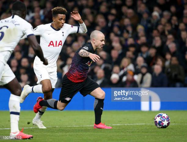 Gedson Fernandes of Tottenham Angelino of RB Leipzig during the UEFA Champions League round of 16 first leg match between Tottenham Hotspur and RB...