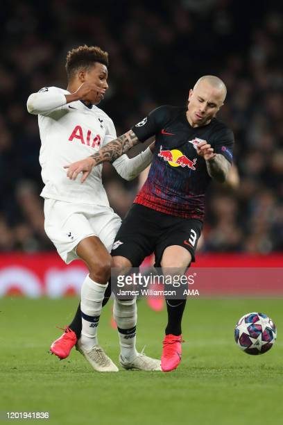 Gedson Fernandes of Tottenham Hotspur and Angelino of RB Leipzig during the UEFA Champions League round of 16 first leg match between Tottenham...