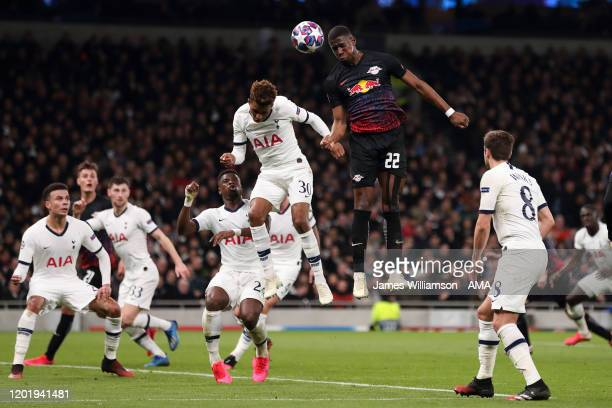 Gedson Fernandes of Tottenham Hotspur and Nordi Mukiele of RB Leipzig during the UEFA Champions League round of 16 first leg match between Tottenham...