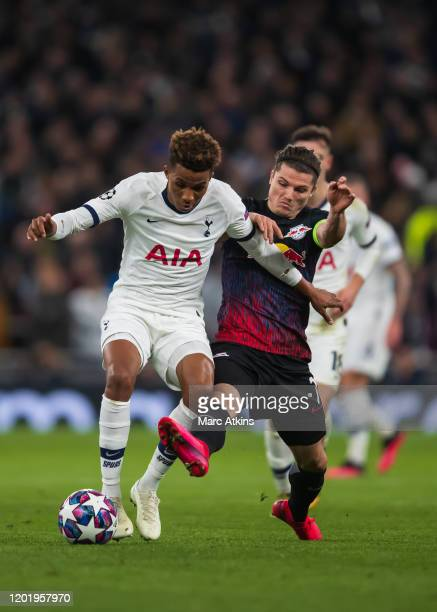 Gedson Fernandes of Tottenham Hotspur in action with Marcel Sabitzer of RB Leipzig during the UEFA Champions League round of 16 first leg match...
