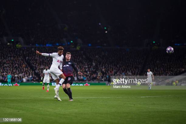 Gedson Fernandes of Tottenham Hotspur shoots watched by Timo Werner of RB Leipzig during the UEFA Champions League round of 16 first leg match...
