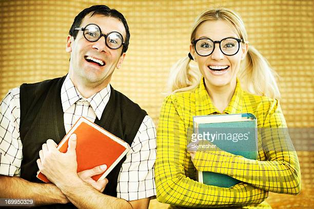 Gee couple holding books.