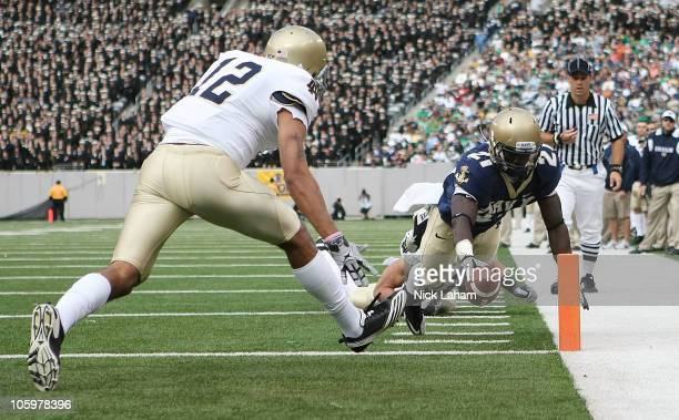 Gee Gee Greene of the Navy Midshipmen dives for a touchdown against Robert Blanton of the Notre Dame Fighting Irish at New Meadowlands Stadium on...