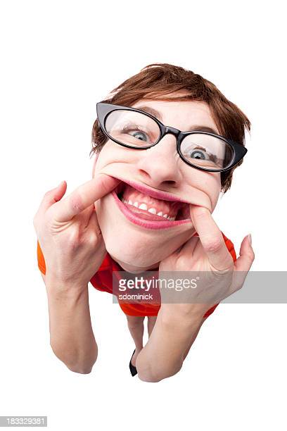 geek making silly face - human gums stock photos and pictures