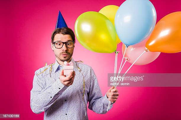 Geek man with pink gift and five balloons, Happy birthday!
