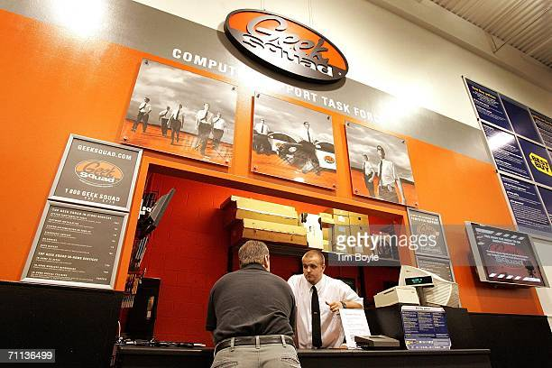 'Geek Squad' agent Eric Fortuna assists customer Charles King at a 'Geek Squad' computer repair facility in a Best Buy store June 6 2006 in Niles...