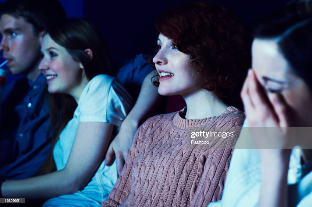 Geeky guy and girl on a date at the movies : Stock Photo