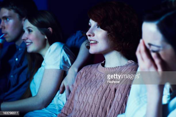 geeky guy and girl on a date at the movies - arts culture and entertainment stock pictures, royalty-free photos & images