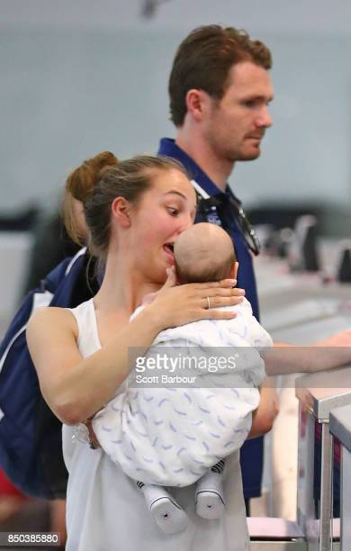 Geelong Cats AFL player Patrick Dangerfield along with his wife Mardi Harwood and son George Dangerfield check in for their flight during a media...