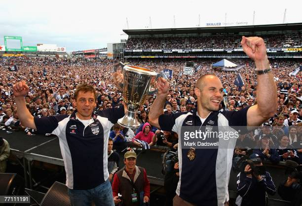 Geelong Cats coach Mark Thompson and captain Tom Harley hold up the premiership cup during a Geelong Cats AFL Premiership Celebration day at Skilled...