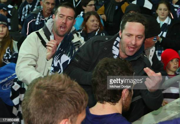 Geelong Cats fan gestures to Hayden Ballantyne of the Dockers after the round 14 AFL match between the Geelong Cats and the Fremantle Dockers at...