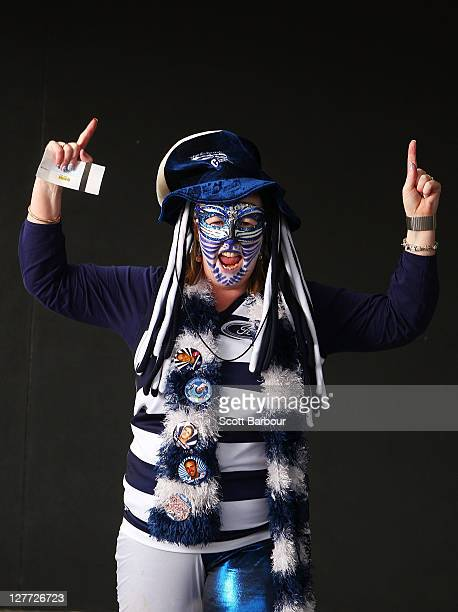 Geelong Cats fan poses for a portrait prior to the start of the 2011 AFL Grand Final match between the Collingwood Magpies and the Geelong Cats at...