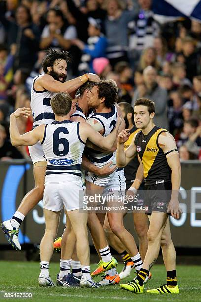 Geelong Cats player celebrates a Tom Hawkins goal during the round 21 AFL match between the Richmond Tigers and the Geelong Cats at Melbourne Cricket...