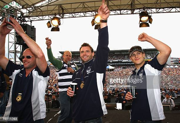 Geelong Cats playera Paul Chapman, Josh Hunt and Gary Ablett wave the their supporters during a Geelong Cats AFL Premiership Celebration day at...